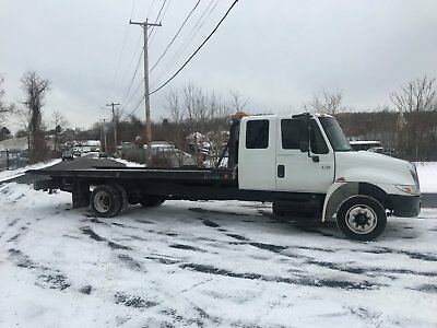 2007 international extra cab flatbed, rollback 212ft century right approach bed