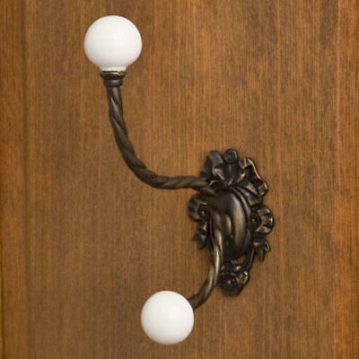 Large Ornate Brass Double Hook with Porcelain Knobs in Antique Brass