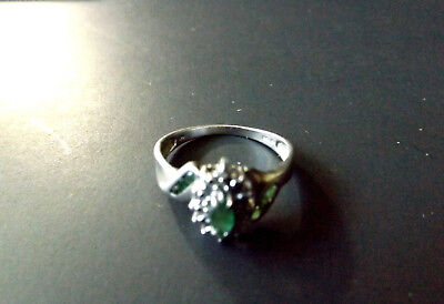 SOLID Sterling Silver 925 Marked  Ring  wight  2 gr  size 8 with green stones