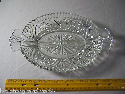 Oval divided dish with handles unmarked cut thick glass has two sections