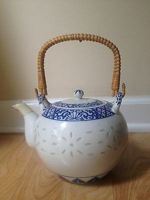 """Vintage Blue & White Porcelain Rice Eyes- Teapot with Wicker Handle, 4 1/4""""  (L)"""