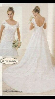 d96f79940 Alfred Angelo Size 14 style 1163 Ivory wedding dress w/very pale pink  beading