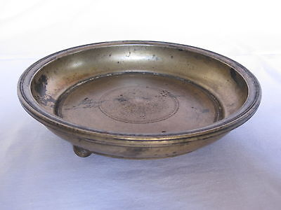 An old antique bronze or bell metal hindu ritual plate with legs, temple use