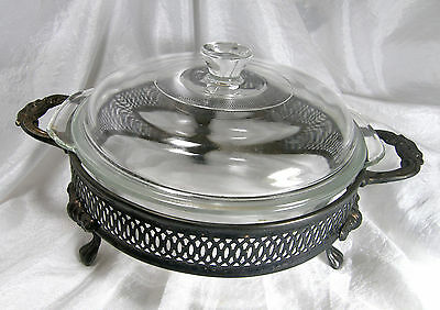 Oven Proof Glass Casserole and Lid In Carrier with 3 Legs and 2 Handles