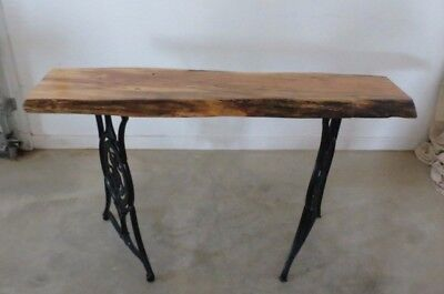 Reclaimed wood accent table with antique Singer sewing machine legs
