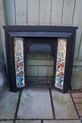 Reclaimed Victorian cast iron fire surround, tile inserts flowers in urn motif