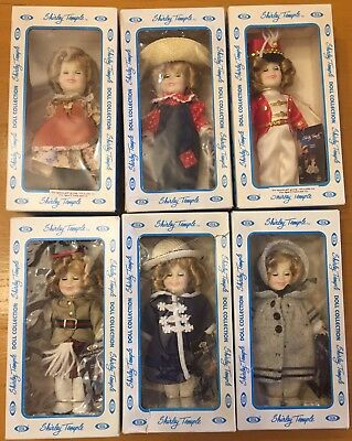 "Set of six 8"" Shirley Temple dolls never removed from original blue boxes"
