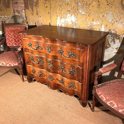 Antique French serpentine cherry wood commode chest of drawers