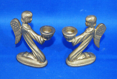A pair of very attractive antique Victorian gothic kneeling angel candlesticks,