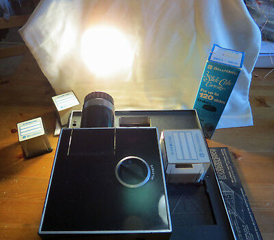 Bell and Howell Slide Cube Projector Model 975Q for 35mm Viewing - xtra gifts...