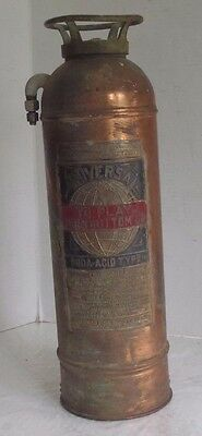 Empty Vintage brass Universal Fire extinguisher by American Fire Company