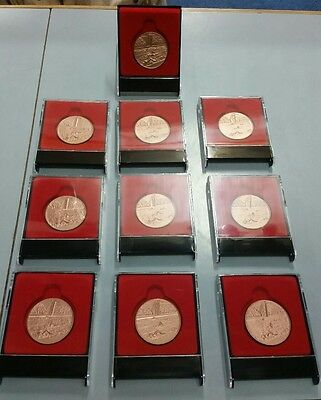 10 x Bronze Swimming Medals each including a display case rrp $120