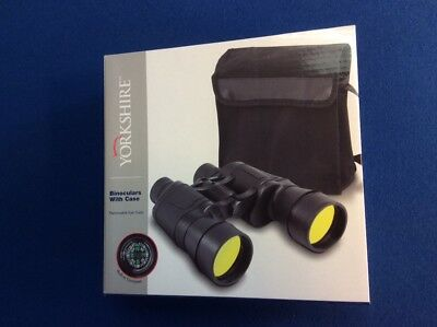 Binoculars with carry case, removable eye cups, built-in compass.  New.