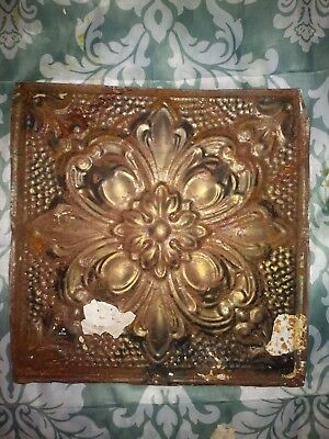 One Antique flur-de-lise ceiling tin tile. 12in x 12in