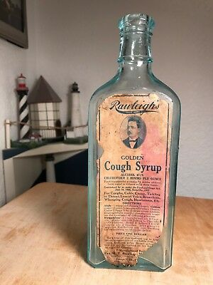 "Late 1800s/Early 1900s Rawleigh's Golden Cough Syrup Antique Bottle 8-3/4"" Tall"
