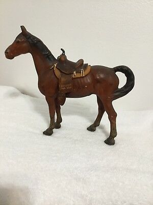 Vintage cast iron horse with leather western saddle