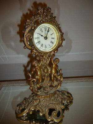 Late 19th Century British United Clock Co - Gilt Brass mantel clock  21 cm tall