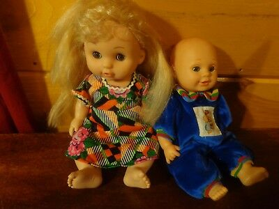 lot of two pretty baby dolls with clothing