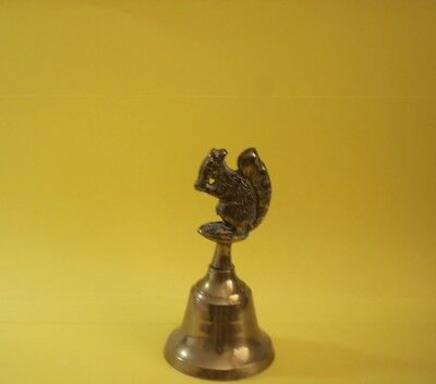 Adorable brass bell of squirrel eating a nut