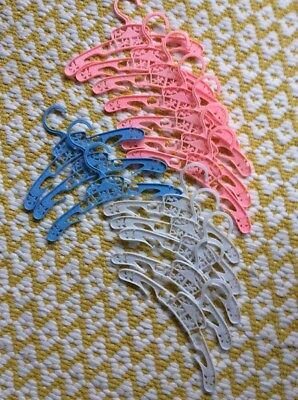 Vintage hangers For A Child X 15 With Cut Out Carousel Design. White/Pink/Blue.