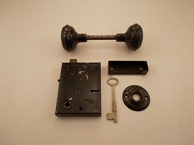 Vintage steel Door Knob set with lock box skeleton key and one back plate.