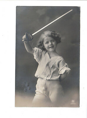 Vintage  Postcard.Child with toy sword.Posted Brockley 1911