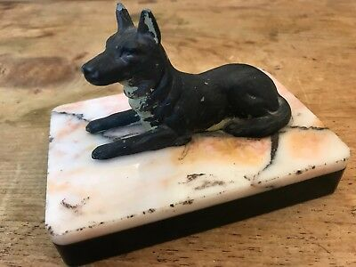 Cold-painted spelter recumbent German Shepherd on marble / onyx base