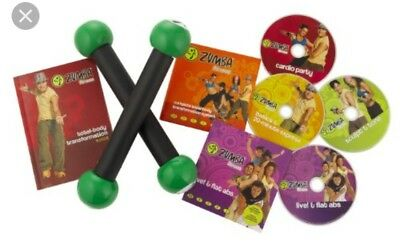 Zumba Fitness Workout  DVD Box Set , 4 DVDs and 2 Toning Sticks in box.