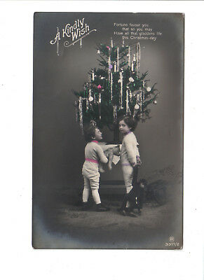 Vintage Christmas Postcard.Two children with decorated tree