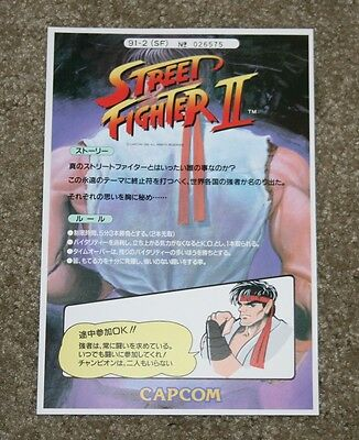 Capcom Street Fighter II official art card and manual