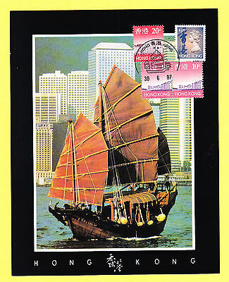 Hong Kong stamps on Tourist Card Postcard entitled Junk Passes By Central 1997