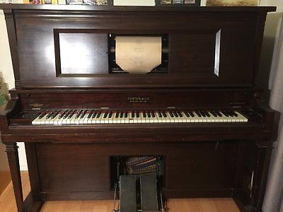 Pianola vintage with Pianola Rolls
