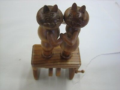 cute carved wooden mechanical kissing cats