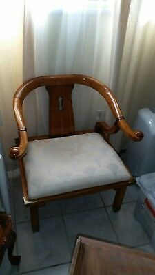 Asian style horseshoe estate arm chair.