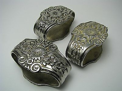 "SET of 3 SILVERPLATE SILVER PLATED NAPKIN RINGS NAPKIN HOLDERS ""Flowers"" ca1900s"