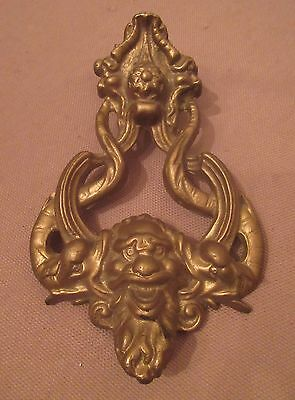 large antique ornate thick brass figural devil dolphin front door knocker arm
