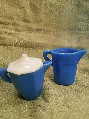 2 Akro Agate creamers, 1 with lid. Blue.  Child's Tea Set