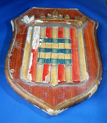 A very unusual quite large damaged medieval shield shaped heraldic plaque