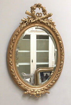 LARGE DECORATIVE CRESTED FRENCH ANTIQUE OVAL GILDED MIRROR c1900
