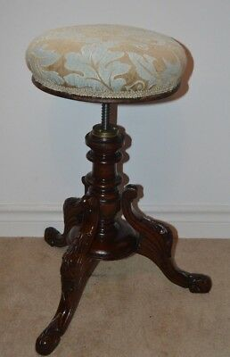 Stunning rise and fall piano stool  in excellent condition with gorgeous fabric