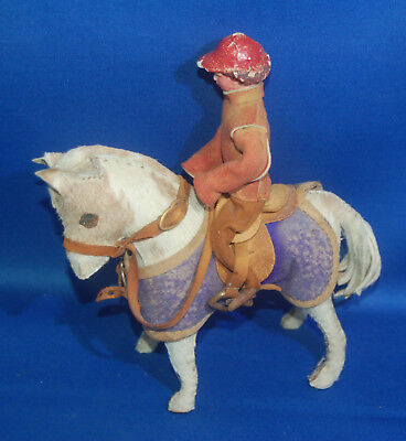 A rare antique skin fur covered Edith Reynolds pony with tack and rider