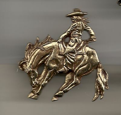 Vintage Sculpted Cowboy Riding Bucking Bronco B old metal badge