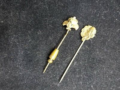 Two vintage Edwardian or Victorian age brass stick pins (hat pins)