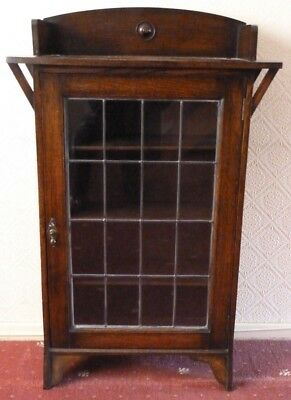 Glass fronted dark oak cabinet with key