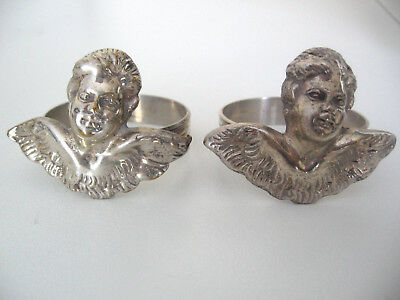 Unusual pair of silver napkin rings decorated with angels