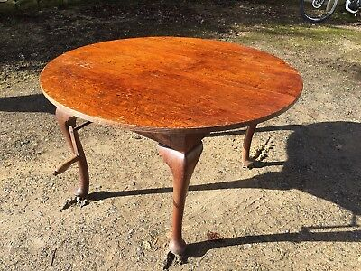 round extending Edwardian dining table