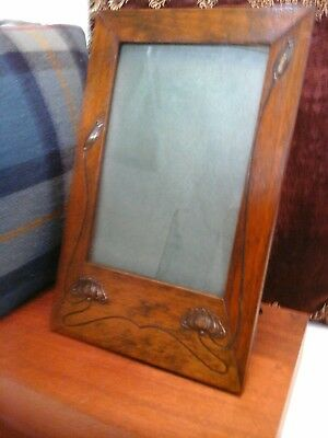 Art Nouveau wooden  picture frame, with Stylised whiplash brass details