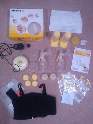 Medela 'Swing maxi' double breast pump plus lots of expressing extras