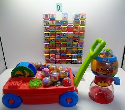 65 Fisher Price Peek A Blocks and 32 Roller Balls & Musical Wagon and Gumball #D