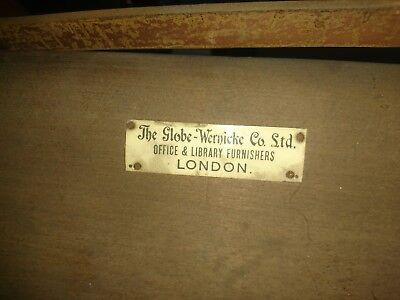 Very old antique cabinet made by the globe wernicke